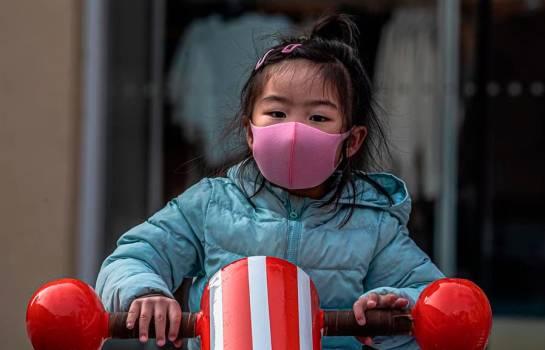 China dice que la situación está 'mejorando' y la epidemia está bajo control